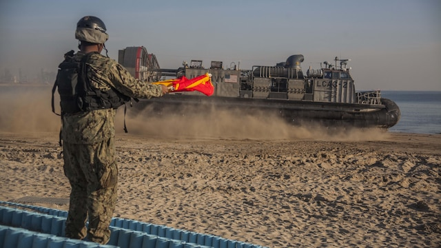 U.S. Navy sailor Seaman Joshua Hall, Naval Beach Party, Naval Beach Unit 7  signals a Landing Craft Air Cushion assigned to NBU 7 during Exercise Ssang Yong 16, Dogu Beach, Pohang, South Korea, March 17, 2016. Ssang Yong 16 is a biennial combined amphibious exercise conducted by U.S. forces with the Republic of Korea Navy and Marine Corps, Australian Army and Royal New Zealand Army forces in order to strengthen interoperability and working relationships across a wide range of military operations. The Marines and sailors of the 31st MEU are currently deployed aboard the Bonhomme Richard Amphibious Ready Group as part of their spring deployment of the Asia-Pacific region.