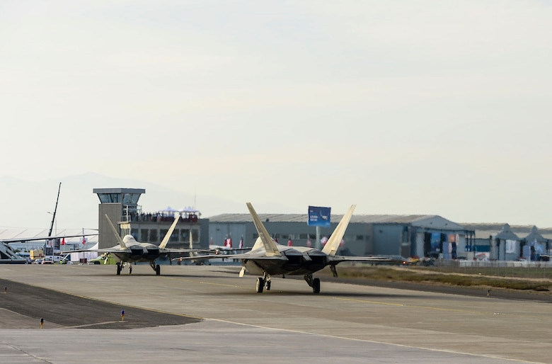 Two F-22 Raptors from Langley AFB, Va., arrived in Santiago, Chile to participate in the International Air and Space Fair (FIDAE), March 27, 2016.  More than 65 Airmen from around the U.S. are scheduled to participate in a variety of activities during the week-long air show that includes aerial demonstrations, interaction with the local community, and subject matter expert exchanges with the Chilean air force. The F-22 Raptor Demonstration Team performs precision aerial maneuvers that demonstrate the unique capabilities of the world's only operational fifth-generation fighter aircraft.  (U.S. Air Force photo by Tech. Sgt. Heather Redman/Released)