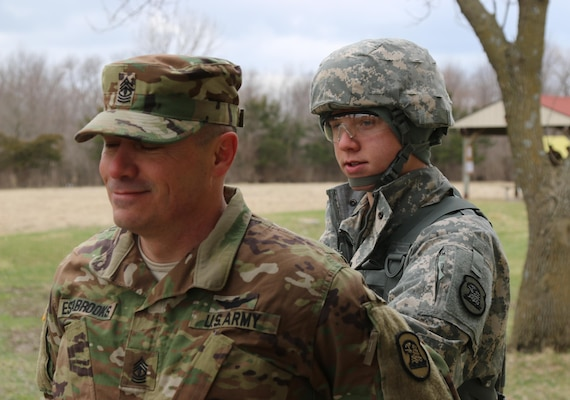 Army Spc. Ethan Estabrooks, a helicopter crew chief and mechanic with the Iowa Army National Guard's Charlie Company, 2nd Battalion, 147th Aviation Regiment, performs a search on his sponsor and father, 1st Sgt. Gary Estabrooks, at the Iowa Best Warrior Competition at Camp Dodge in Johnston, Iowa, March 19, 2016. After the three-day event, one noncommissioned officer and one junior enlisted soldier were selected to represent Iowa in May's regional Best Warrior Competition in Ohio. Iowa Army National Guard photo by Sgt. Andrew Shipley
