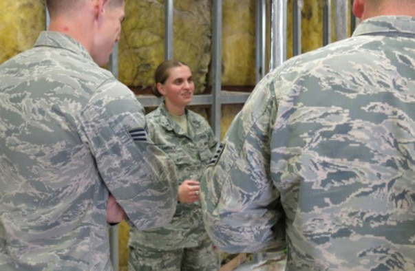 First Lt. Amela Kamencic, a former Bosnian refugee who now works as the 379th Expeditionary Civil Engineer Squadron operations engineering officer-in-charge, speaks with members of her team about ongoing renovations throughout Al Udeid Air Base, Qatar, March 16, 2016. (U.S. Air Force photo/Maj. Angela Webb)