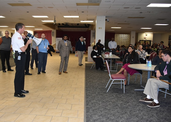 Donald Rogers, fire chief, Defense Logistics Agency Installation Support at Richmond addresses a group of employees inside the Center Restaurant on Defense Supply Center Richmond, Virginia, who participated in the installation's tornado drill March 22, 2016.