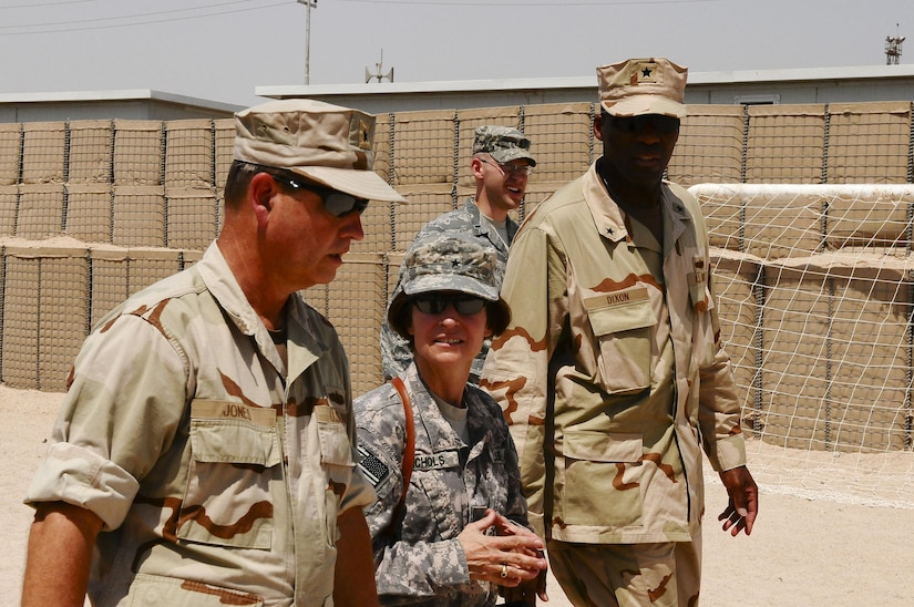 """Navy Rear Adm. Jeffrey """"Scott"""" Jones, Coalition Naval Advisory Training Team director, left, and Army Brig. Gen. Camille M. Nichols, commanding general, Joint Contracting Command, U.S. Forces Iraq, tour Umm Qasr, Iraq, Sept. 7, 2010. Nichols visited with the team's combined forces to view the latest progress at Iraq's southernmost port. Army photo by Sgt. David Scott"""