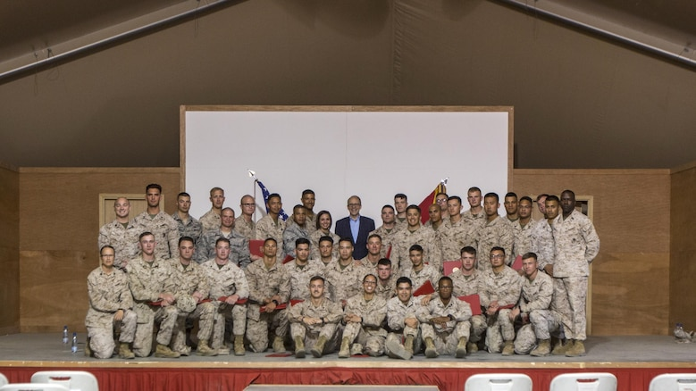 Ambassador Douglas A. Silliman, back center, the U.S. Ambassador to Kuwait, takes a group photo with the Special Purpose Marine Air Ground Task Force-Crisis Response-Central Command Corporals Course staff and graduates in Kuwait on March 25, 2016. The corporals' leadership program is designed to provide instruction for tasks developed in accordance with Marine Corps Order 1510.90, Individual Training Standards. Corporals Course is a professional military education requirement for all corporals to complete in order to be qualified for promotion.