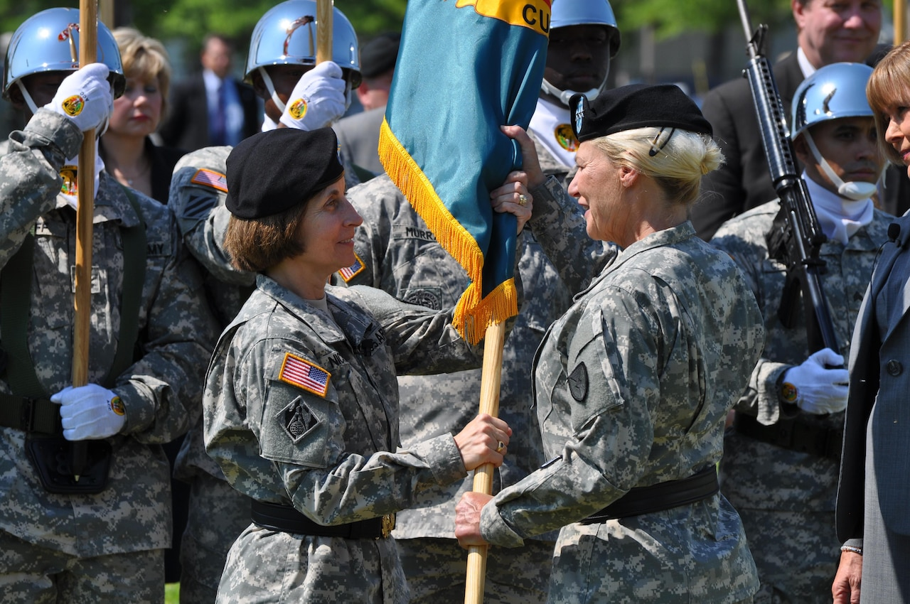 Army Maj. Gen. Camille M. Nichols accepts the U.S. Army Contracting Command flag from Gen. Ann Dunwoody, Army Materiel Command commanding general, during an assumption-of-command ceremony at Redstone Arsenal, Ala., May 17, 2012. Nichols served as the contracting command's first commanding general. Army photo