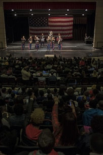 The party band section of the Marine Corps Base Quantico band plays to a full Everett High School auditorium, March 18. The band visited the school prior to their performance in the St. Patrick's Day parade in Boston, Massachusetts, the following weekend.
