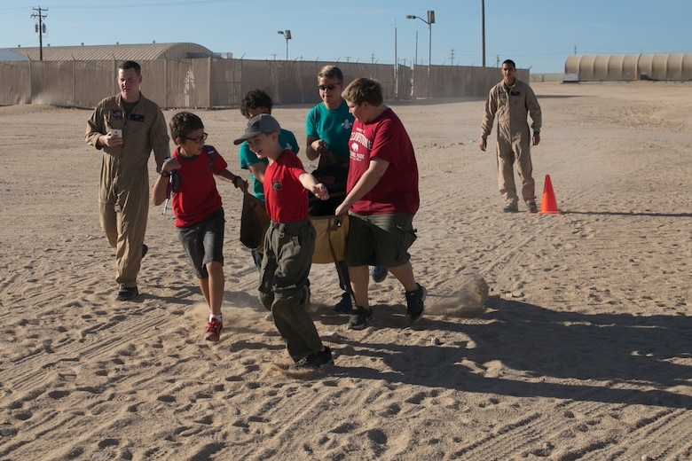 Boy scouts with Troop 180 perform a medical evacuation drill under the supervision of Marines from Marine Wing Support Squadron 374 during a Boy Scout Camp Out at Camp Wilson, March 19, 2016. (Official Marine Corps photo by Cpl. Medina Ayala-Lo/Released)