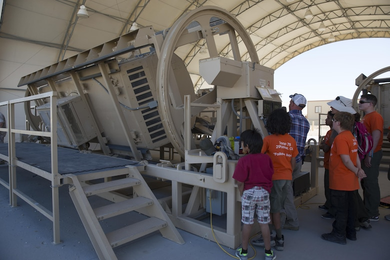 Local Boy Scouts of America troops observe and participate in the Rollover Simulator at the Battle Simulation Center located at Camp Wilson during the Boy Scout Camp Out for local Boy Scouts of America troops March 18, 2016. (Official Marine Corps photo by Sgt. Charles Santamaria/Released)