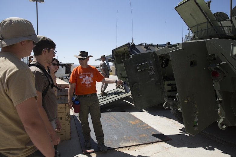 Col. Jay Wylie, assistant chief of staff, G-4 Logistics, explains the purpose and design of the Marine Corps' Amphibious Assault Vehicle to boy scouts at the Exercise Support Division's staging area during the Boy Scout Camp Out for local Boy Scouts of America troops March 18, 2016. (Official Marine Corps photo by Sgt. Charles Santamaria/Released)