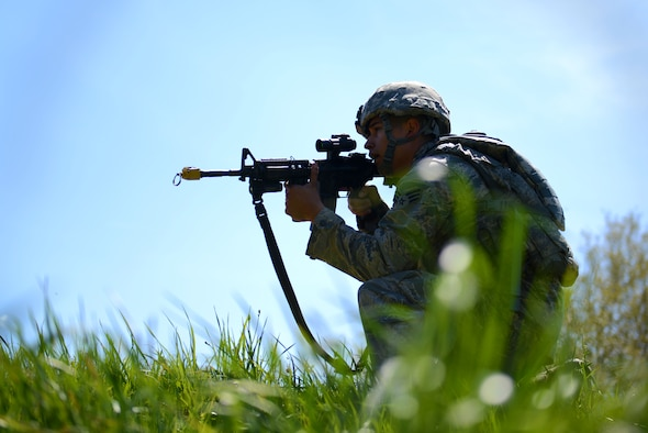 A U.S. Airman assigned to the 20th Security Forces Squadron takes a position to cover his wingmen during a simulated attack during operational readiness exercise Weasel Victory 16-08 at Shaw Air Force Base, S.C., March 23, 2016. OREs are a vital tool used by the Department of Defense to test and train troops for combat situations. (U.S. Air Force photo by Airman 1st Class Kelsey Tucker)