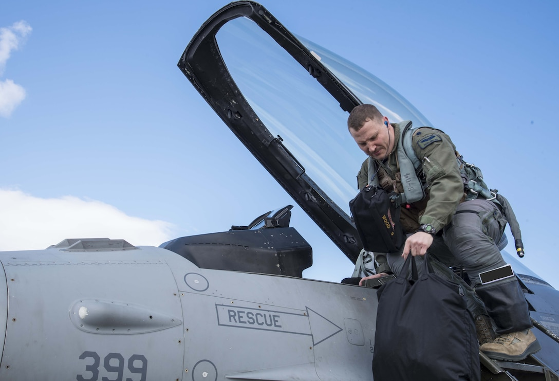 U.S. Air Force Lt. Col. Paul Miller, the deputy commander of the 35th Operations Group, climbs into an F-16 Fighting Falcon during exercise Beverly Sunrise 16-03 at Misawa Air Base, Japan, March 23, 2016. As part of phase II of the operational readiness exercise, Misawa AB simulated a deployment to Kadena Air Base, Japan, during which they conducted contingency operations. (U.S. Air Force photo by Airman 1st Class Jordyn Fetter/Released)