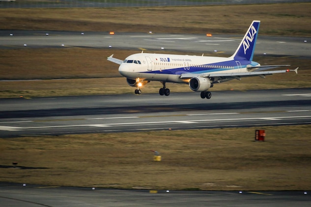 An ANA flight lands on Marine Corps Air Station Iwakuni, Japan, March 25, 2016. On March 27, 2016, The Iwakuni Kintaikyo Airport Use Promotion Council and distinguished guests celebrated the addition of two new flights to the Iwakuni Kintaikyo Airport, March 27, 2016. (U.S. Marine Corps photo by Lance Cpl. Jacob Farbo/Released)