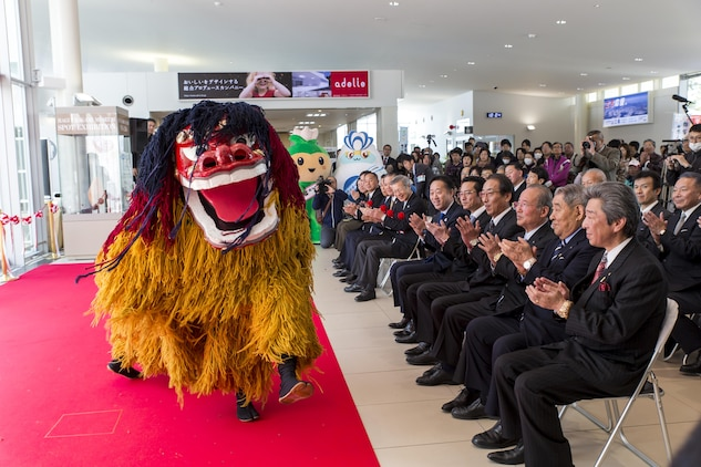 The Iwakuni Kintaikyo Airport Use Promotion Council and distinguished guests celebrate the addition of two new flights to the Iwakuni Kintaikyo Airport March 27, 2016. The celebration included an Eisaa Okinawa Drum Demonstration, a Ryuky-Koku-Matsuri Daiko Drum performance and a ribbon cutting ceremony. Distinguished guests expressed their appreciation toward the Ministry of Defense; Ministry of Land, Infrastructure, and Transport; MCAS Iwakuni and other organizations involved in the adoption of these new flights. The airport and additional flights will contribute to the exchange of people and culture among Iwakuni, Okinawa and other countries in the region. (U.S. Marine Corps photo by Sgt. Antonio J. Rubio/Released)