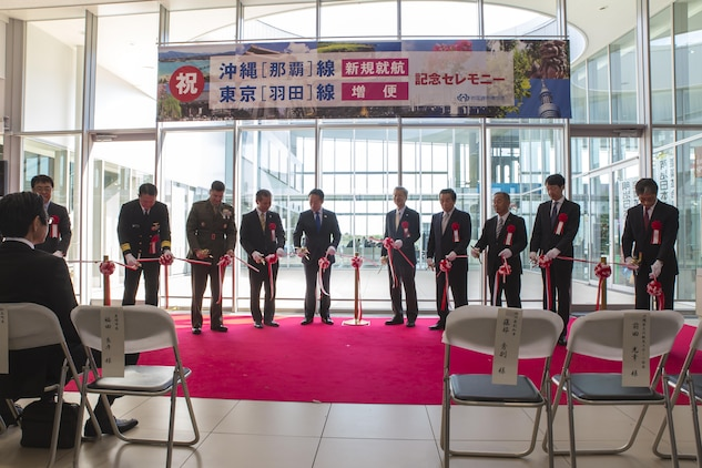 The Iwakuni Kintaikyo Airport Use Promotion Council and distinguished guests celebrate the addition of two new flights to the Iwakuni Kintaikyo Airport by cutting a ribbon March 27, 2016. The celebration also included an Eisaa Okinawa Drum Demonstration, a Ryuky-Koku-Matsuri Daiko Drum performance. Distinguished guests expressed their appreciation toward the Ministry of Defense, Ministry of Land, Infrastructure, and Transport, MCAS Iwakuni and other organizations involved in the adoption of these new flights. The airport and additional flights will contribute to the exchange of people and culture among Iwakuni, Okinawa and other countries in the region. (U.S. Marine Corps photo by Sgt. Antonio J. Rubio/Released)
