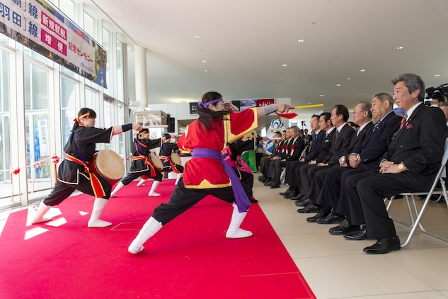 The Iwakuni Kintaikyo Airport Use Promotion Council and distinguished guests celebrate the addition of two new flights to the Iwakuni Kintaikyo Airport, March 27, 2016. The celebration included an Eisaa Okinawa Drum Demonstration, a Ryuky-Koku-Matsuri Daiko Drum performance and a ribbon cutting ceremony. Distinguished guests expressed their appreciation toward the Ministry of Defense, Ministry of Land, Infrastructure, and Transport, MCAS Iwakuni and other organizations involved in the adoption of these new flights. The airport and additional flights will contribute to the exchange of people and culture among Iwakuni, Okinawa and other Asian countries. (U.S. Marine Corps photo by Sgt. Antonio J. Rubio)