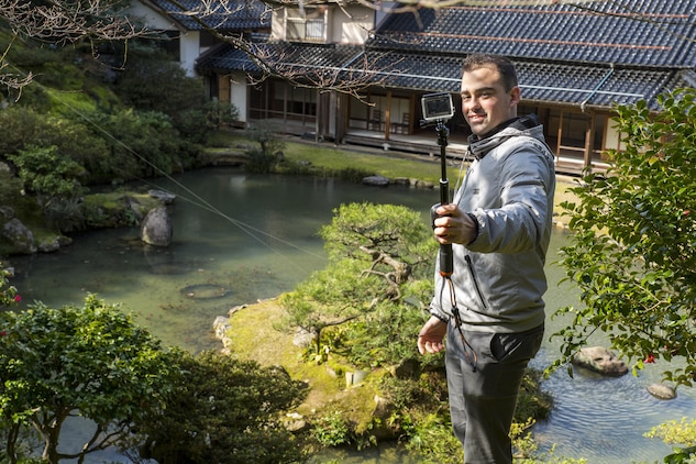 Lance Cpl. Yoan Padezhki, aviation supply specialist with Marine Aerial Refueler Transport Squadron(VMGR) 152, located at Marine Corps Air Station Iwakuni, takes a picture with his camera during a Single Marine Program trip to Kannon-in Temple in Tottori Sakyu, Japan, March 20, 2016. During the two-day trip, Marines also visited the Kannon-in Temple on the eastern side of Tottori City. Constructed during the Edo Period from 1603-1867, the temple is best known for its Japanese-style landscape garden consisting of a large pond surrounded by a lawn and tall pine and maple trees. (U.S. Marine Corps photo by Lance Cpl. Aaron Henson/Released)