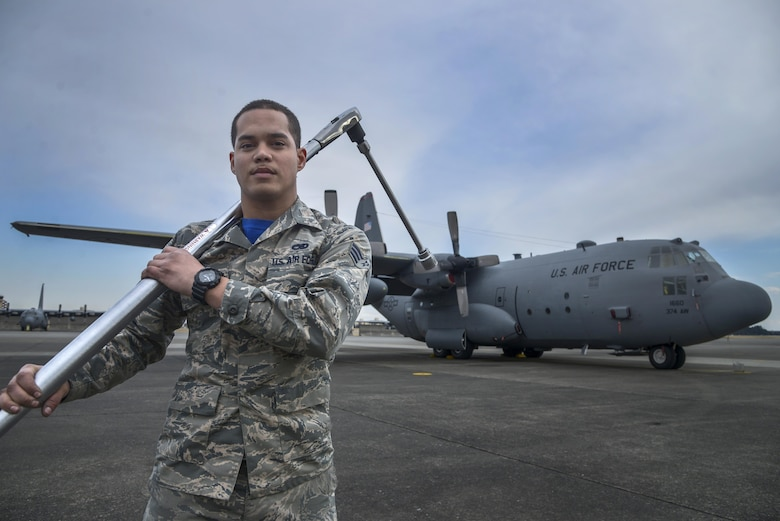 Senior Airman David Rivera, 374th Maintenance Flight aerospace propulsion journeyman, holds a torch wrench in front of a C-130 Hercules at Yokota Air Base, Japan, Feb. 26, 2016. Providing in depth maintenance on the aircraft ensures that Yokota's mission of generating a professional airlift throughout the region is not impacted. (U.S. Air Force photo by Senior Airman David Owsianka/Released)