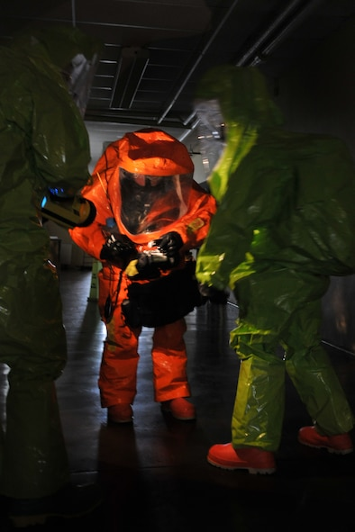 Members of the 180th Fighter Wing Ohio Air National Guard and 127th Wing Michigan National Guard prepare themselves by gathering the instruments necessary before making entry into a simulated hazmat lab in an abandoned downtown Toledo school March 10, 2016. The training exercise was designed to enhance familiarization of equipment and build partnership with civil and military organizations to strengthen real-world emergency response capabilities. (Air National Guard photo by Airman 1st Class Benjamin A. Maciejewski)