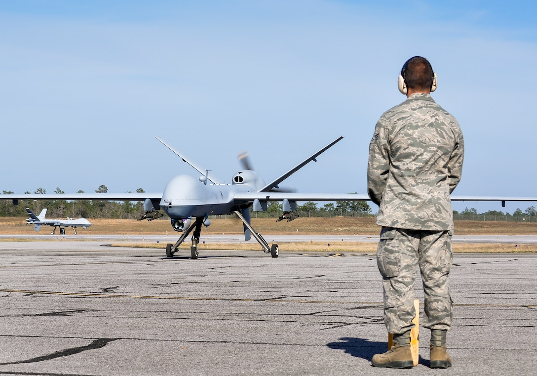 Senior Airman Frank, 49th Aircraft Maintenance Squadron crew chief, watches as an MQ-9 Reaper taxis on the flightline March 15, at Duke Field, Fla., after completing the day's mission. This marked the second appearance ever by the unmanned aerial vehicle in the air-to-ground Weapon System Evaluation Program, Combat Hammer. (U.S. Air Force photo by Susan Garcia)