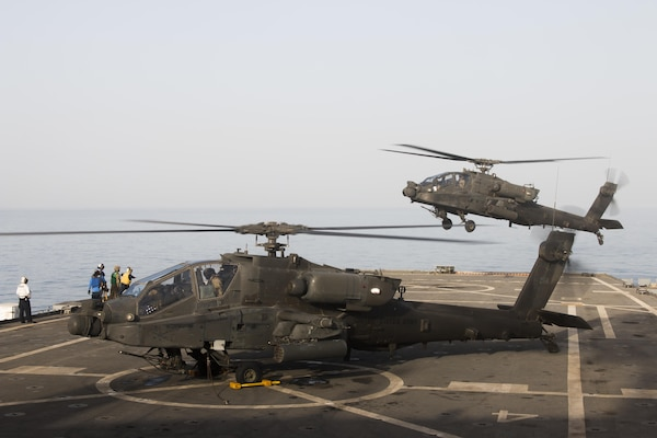 AH-64 Apache helicopters from 3rd Squadron, 6th Cavalry Regiment, land aboard the USS Ponce, an Afloat Forward Staging Base, during an interoperability training exercise in the Persian Gulf March 17. The exercise tested the ability of 40th CAB and the USS Ponce to work together to perform stability operations in the surrounding region.