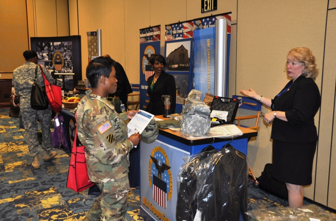 DLA Troop Support representative Sally Pooler (right) answers questions from a soldier at the Warfighter Support Initiative, Fort Bragg, North Carolina, March 23, 2016.