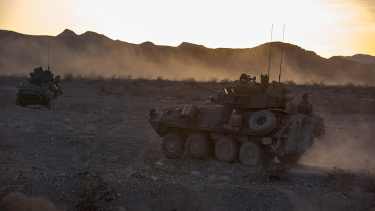 Light armored vehicles with Company B, 3rd Light Armored Reconnaissance Battalion, move into a security position in the Combat Center training area March 24, 2016, during a Marine Corps Combat Readiness Evaluation Exercise. 3rd LAR conducted a five-day MCCREE to evaluate the combat readiness of B Co.