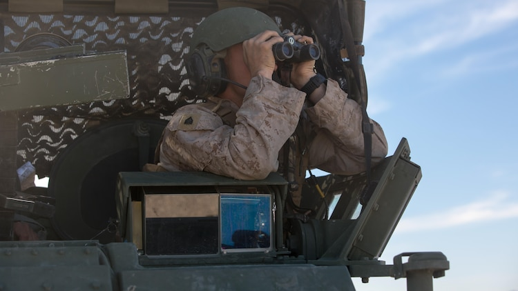 Sgt. Torry L. Broome, light armored vehicle crewman, Company B, 3rd Light Armored Reconnaissance Battalion, searches for potential threats through binoculars in the Combat Center training area March 23, 2016, during a Marine Corps Combat Readiness Evaluation Exercise. 3rd LAR conducted a five-day MCCREE to evaluate the combat readiness of B Co.