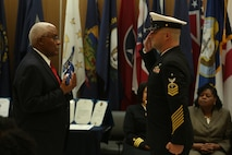 Raymond Applewhite, left, NHCL public affairs director, is presented with an American flag for his service during his retirement ceremony at the hospital quarterdeck on Marine Corps Base Camp Lejeune Dec. 18. Applewhite enlisted in the Navy in 1971, served at the hospital for his first duty station and retired as a senior chief hospital corpsman after 22 years in the Navy. After his service in the Navy, Applewhite returned to the hospital for civil service. (U.S. Marine Corps photo by Cpl. Mark Watola /released)