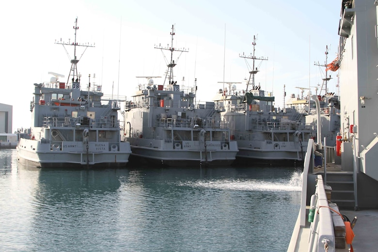 Landing Craft Utility boats sit in dock at the Kuwait Naval Base as part of APS-5 Kuwait, an army prepositioned wartime stocks program. APS-5 maintains over 30 Army watercraft in ready-for-issue condition as part of Army Central's contingency operations strategy. (U.S. Army photo by Master Sgt. Dave Thompson, released)