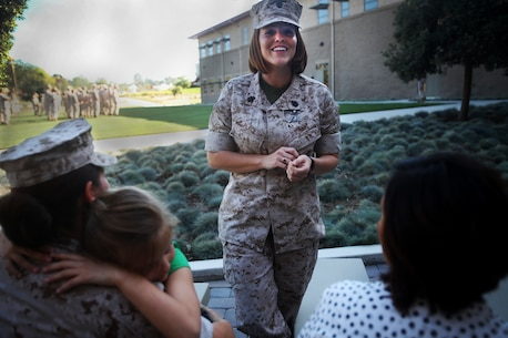 Chief Petty Officer Jaclyn Place laughs at a joke while she waits for her award ceremony to begin aboard Camp Pendleton, Calif., March 11, 2016. Place is a lead chief petty officer with the Headquarters Regimental Aid Station, 1st Marine Logistics Group, and was awarded an Impact Navy and Marine Corps Commendation Medal for her selfless and decisive actions that saved the lives of her neighbors. (U.S. Marine Corps photo by Sgt. Laura Gauna/released)