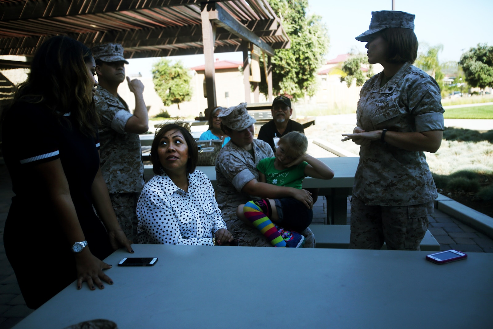 Chief Petty Officer Jaclyn Place waits with her neighbors during her award ceremony aboard Camp Pendleton, Calif., March 11, 2016. Place is a lead chief petty officer with the Headquarters Regimental Aid Station, 1st Marine Logistics Group, and was awarded an impact Navy and Marine Corps Commendation Medal for her selfless and decisive actions that saved the lives of her neighbors. (U.S. Marine Corps photo by Sgt. Laura Gauna/released)