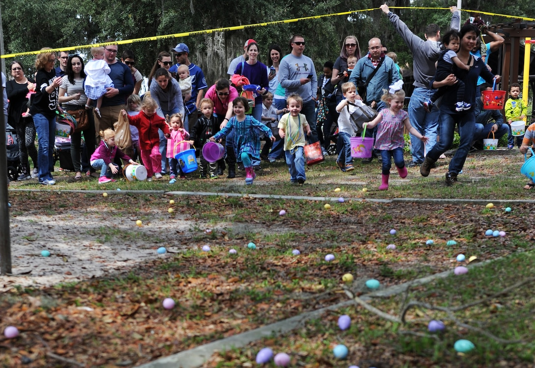 Children participate in an Easter egg hunt during Easter in the Park at the marina Mar. 26, 2016, Keesler Air Force Base, Miss. The event also included a youth fun run, arts and crafts, games and visits with the Easter Bunny. (U.S. Air Force photo by Kemberly Groue)