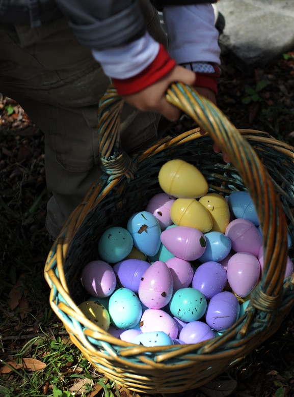 An Easter egg basket is carried during Easter in the Park's egg hunt at the marina Mar. 26, 2016, Keesler Air Force Base, Miss. The event also included a youth fun run, arts and crafts, games and visits with the Easter Bunny. (U.S. Air Force photo by Kemberly Groue)