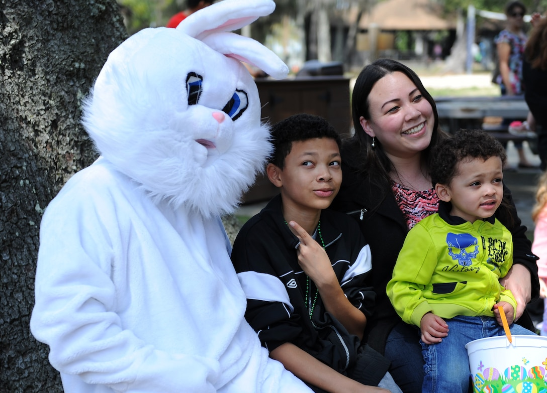 Jennifer, Bryant and Jeremy McNeal, family of retired U.S. Air Force Capt. Cozy McNeal, take a family photo with the Easter Bunny during Easter in the Park at the marina Mar. 26, 2016, Keesler Air Force Base, Miss. The event also included an egg hunt, youth fun run, arts and crafts and games. (U.S. Air Force photo by Kemberly Groue)