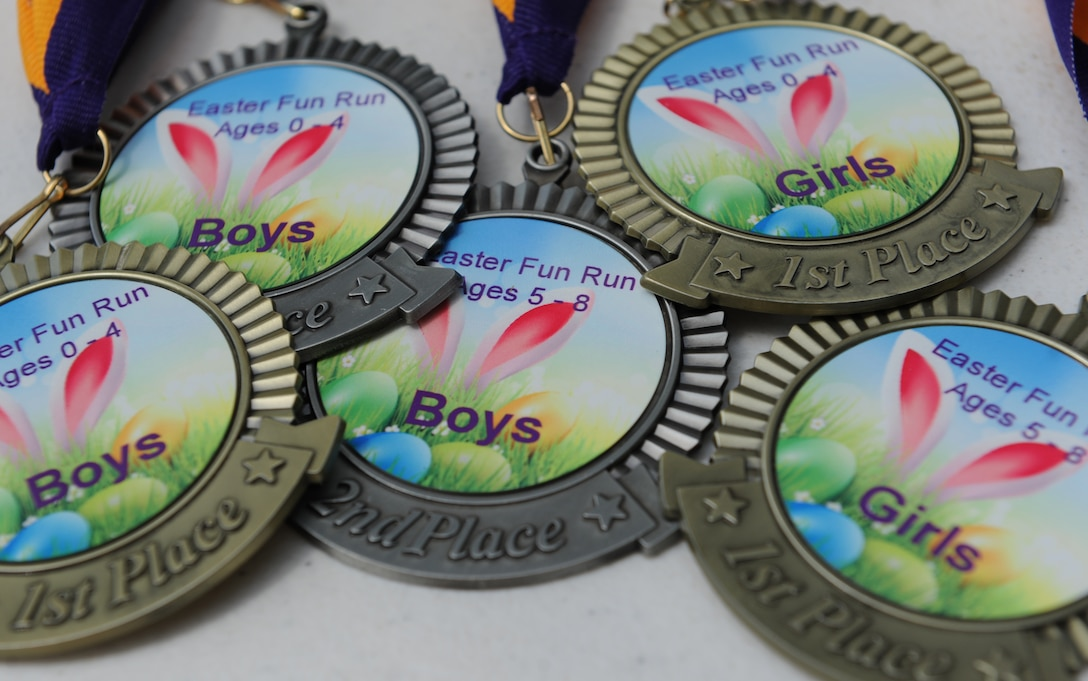 Youth Fun Run medals sit on display during Easter in the Park at the marina Mar. 26, 2016, Keesler Air Force Base, Miss. Easter in the Park also included an egg hunt, arts and crafts, games and visits with the Easter Bunny. (U.S. Air Force photo by Kemberly Groue)