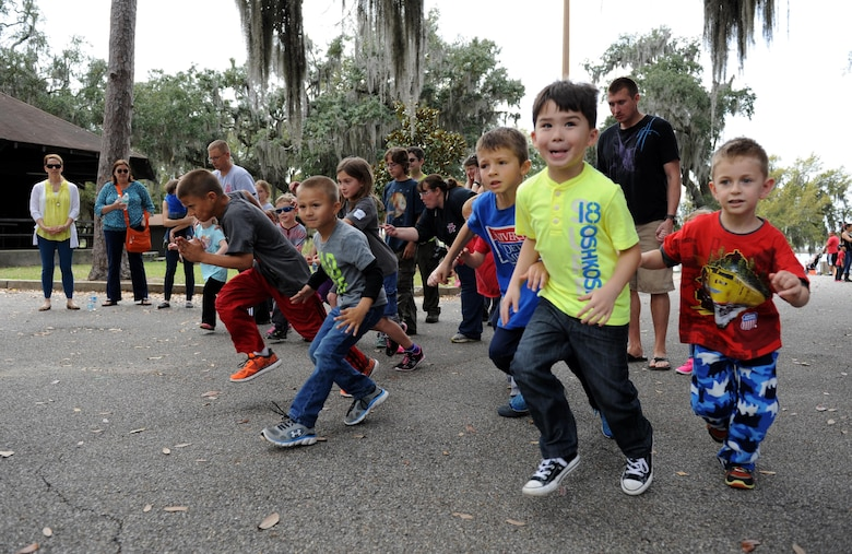 Keesler children participate in an Easter Fun Run during Easter in the Park at the marina Mar. 26, 2016, Keesler Air Force Base, Miss. The event also included an egg hunt, arts and crafts, games and visits with the Easter Bunny. (U.S. Air Force photo by Kemberly Groue)