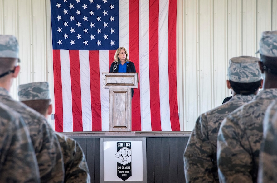 Secretary of the Air Force Deborah Lee James addresses basic trainees currently in the Basic Expeditionary Airmen Skills Training (BEAST) course March 22, 2016, at the 319th Training Squadron on Joint Base San Antonio-Lackland, Texas. James visited the 37th Training Wing to learn about the Forward Operating Base (FOB) of the Future project, a joint venture between the Air Force Research Laboratory and the University of Dayton Research Institute which converted one zone of the BEAST complex to generate onsite power from renewable energy. The data from this prototype will help guide remaining technology maturation efforts and potentially accelerates the modernization of FOBs throughout the Defense Department.  (U.S. Air Force photo/Johnny Saldivar)