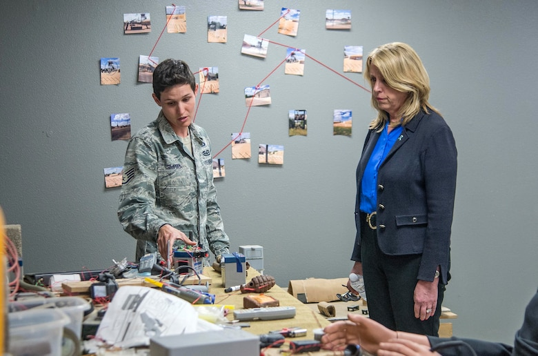 Staff Sgt. Britney Simpson, a 319th Training Squadron military training instructor, briefs Secretary of the Air Force Deborah Lee James on the anti-terrorism course taught at the Basic Expeditionary Airmen Skills Training (BEAST) Course March 22, 2016, on Joint Base San Antonio-Lackland, Texas. James visited the 37th Training Wing to learn about the Forward Operating Base of the Future project, a joint venture with the Air Force Research Labratory and the University of Dayton Research Institute which converted one zone of the BEAST complex to generate onsite power from renewable energy. The BEAST site hosts the Air Force basic military training's field week where a warrior ethos is instilled in trainees as they complete various combat and confidence building skills such as combatives, a leadership reaction course and courses on the U.S. Code of Conduct. (U.S. Air Force photo/Johnny Saldivar)