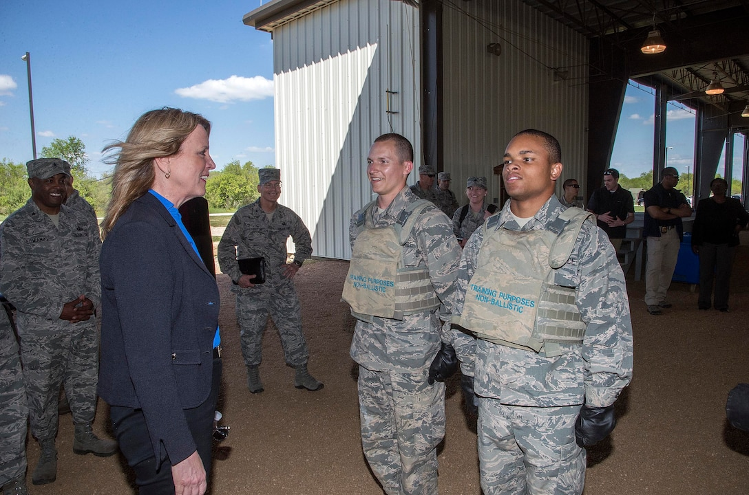 Secretary of the Air Force Deborah Lee James speaks with two basic trainees before a demonstration at the Basic Expeditionary Airmen Skills Training (BEAST) course March 22, 2016, at the 319th Training Squadron on Joint Base San Antonio-Lackland, Texas. James visited Lackland to view the Forward Operating Base of the Future, an Air Force initiative to increase energy efficiency at the BEAST site by converting one of the six zones into a completely solar powered area. James was given a tour of the BEAST complex, which hosts the Air Force basic military training's field week where a warrior ethos is instilled in trainees as they complete various combat and confidence building skills such as combatives, a leadership reaction course and courses on the U.S. Code of Conduct. (U.S. Air Force photo/Johnny Saldivar)