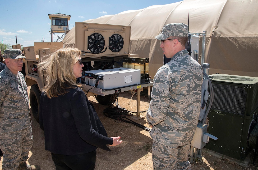 Secretary of the Air Force Deborah Lee James speaks with 1st Lt. Jonathan Goins,the  energy and environment research engineer with the Air Force Research Laboratory (AFRL), about the process of converting an area of the Basic Expeditionary Airmen Skills Training (BEAST) site to operate completely on solar power March 22, 2016, at the 319th Training Squadron on Joint Base San Antonio-Lackland, Texas. James visited the 37th Training Wing to learn about the Forward Operating Base (FOB) of the Future project, a joint venture between the AFRL and the University of Dayton Research Institute which converted one zone of the BEAST complex to generate onsite power from renewable energy. The data from this prototype will help guide remaining technology maturation efforts and potentially accelerates the modernization of FOBs throughout the Defense Department. (U.S. Air Force photo/Johnny Saldivar)