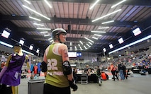 U.S. Air Force Maj. Jocelyn Smith, an executive officer with the 55th Wing Headquarters, looks over her shoulder at the scoreboard as the men's roller derby games comes to an end at the Ralston Arena, Neb., March 26, 2016. Smith is an all-star roller derby member of the Omaha Rollergirls derby team.  (U.S. Air Force photo by Josh Plueger/Released)