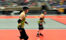 U.S. Air Force Maj. Jocelyn Smith, an executive officer with the 55th Wing Headquarters, skates a few warm up laps prior to the roller derby bout held at the Ralston Arena, Neb., March 26, 2016. Known as Amelia Airhurt, Smith is an All-Star roller derby member of the Omaha Rollergirls.  (U.S. Air Force photo by Josh Plueger/Released)
