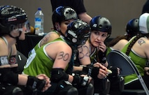 U.S. Air Force Maj. Jocelyn Smith, an executive officer with the 55th Wing Headquarters, takes a quick break from the roller derby game held at the Ralston Arena, Neb., March 26, 2016. Once she dons her skates, Smith becomes Amelia Airhurt of the Omaha Rollergirls derby team.  (U.S. Air Force photo by Josh Plueger/Released)