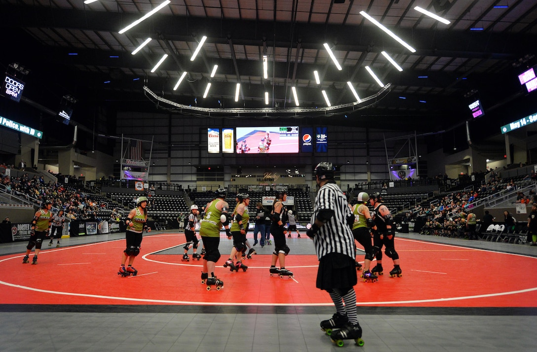The Omaha Rollergirls take on the Sioux City Roller Dames in a bout held at the Ralston Arena, Neb., March 26, 2016. One of the All-Star jammers of the Rollergirls in an executive officer with the 55th Wing Headquarters known as Maj. Jocelyn Smith, but by night, Amelia Airhurt.  (U.S. Air Force photo by Josh Plueger/Released)