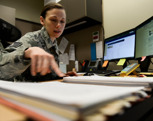 Staff Sgt. Nissi Scholl, 366th Contracting Squadron contracting officer reviews a contract for the fitness center at Mountain Home AFB, Idaho, March 29, 2016. Contracting officers like Scholl are the final step in the contract-approval process.