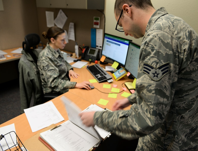 Senior Airman Stephan Giorgio (right), 366th Contracting Squadron contract specialist and Staff Sgt. Nissi Scholl, 366th CONS contracting officer, discuss a contract at Mountain Home AFB, Idaho, March 29, 2016. Contract specialists and contracting officers work hand-in-hand to ensure both customers and contractors get the most of out their money.