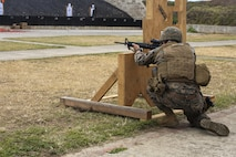 MARINE CORPS BASE HAWAII — Cpl. Zachary Summers, a radio operator with 3rd Radio Battalion, kneels behind a barrier during a Pacific Combat Shooting Match at the Kaneohe Bay Range Training Facility aboard Marine Corps Base Hawaii, March 16, 2016. Teams from different units used various weapons and tactics to achieve the fastest time possible on different courses of fire, while earning points for awards during the competition. Marines from the Marine Corps Combat Shooting Team instructed and gave advice to the Marines participating in the event. (U.S. Marine Corps Photo by Lance Cpl. Jesus Sepulveda Torres)