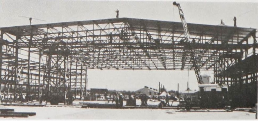 Hangar well-along in construction at PAAB.  In order to hasten completion of new air bases, Army plans called for one aircraft maintenance hangar at new air bases.  (Courtesy Portland District, Army Corps of Engineers)