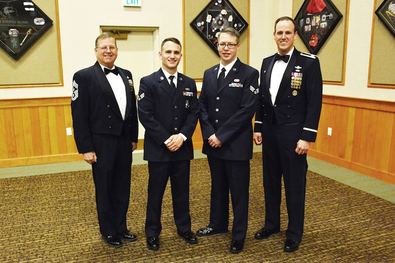 120th Airlift Wing Commander Col. Lee Smith (right) and the 120th Airlift Wing Command Chief, Chief Master Sgt. Steven Lynch (left), stand with the wing's newest Airman Leadership School graduates (center left to right), Senior Airman Nicholaus Schwall and Senior Airman Nikolas Asmussen, following their graduation ceremony held at Malmstrom Air Force Base, Mont., March 22, 2016. (U.S. Air National Guard photo by Senior Master Sgt. Eric Peterson)