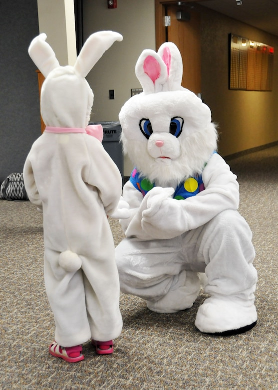 A child dressed as the Easter Bunny meets the Easter Bunny during the Easter eggstravaganza party held for the children of Montana Air National Guard members at the 120th Airlift Wing in Great Falls, Mont., March 23, 2016. (U.S. Air National Guard photo by Senior Master Sgt. Eric Peterson)