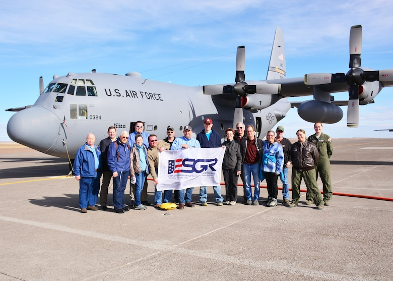 "Employers and community leaders pose in front of a 120th Airlift Wing C-130 Hercules transport aircraft during the Employer Support of the Guard and Reserve (ESGR) ""Breakfast with the Boss"" event held on base in Great Falls, Mont. March 5, 2016.   (U.S. Air National Guard photo by Senior Master Sgt. Eric Peterson)"